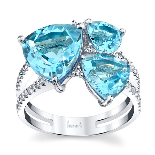 14Kt White Gold Contemporary Three Stone Design of Trillion Shaped Blue Topaz and Diamond Ring
