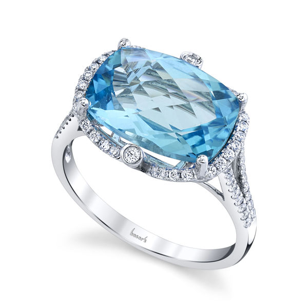 14kt White Gold Enchanting Blue Topaz and Diamond Halo Ring